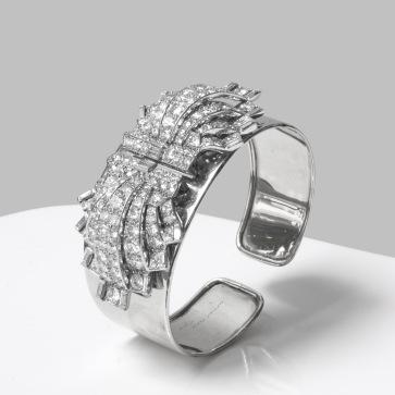 Cartier - Bracelet double clips, platine, or et diamants - 1920 / 1925